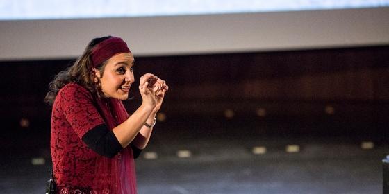 Performer Alia Alzougbi on stage